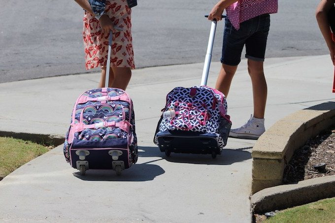 Andrea's kids going to their first day of classes.