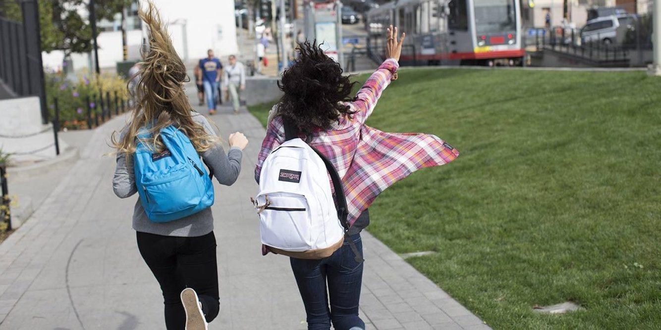Girls running in the school.