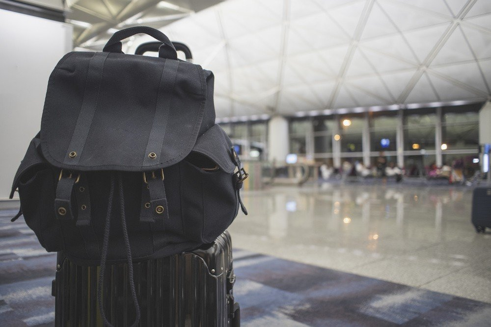 how to attach backpack to rolling suitcase